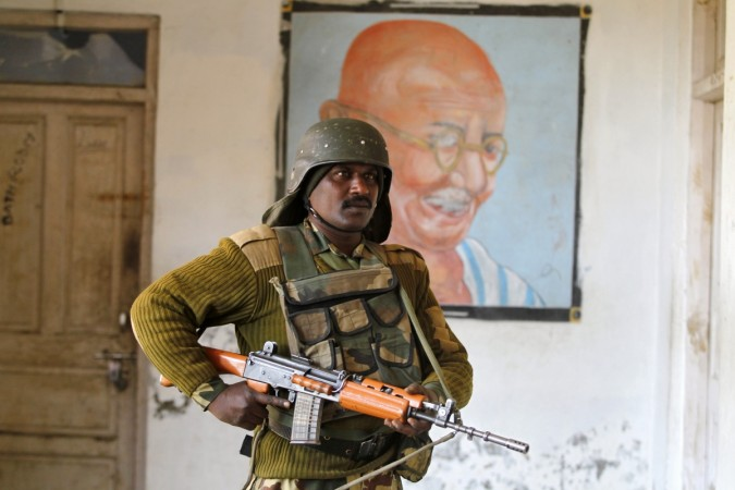 An Indian security personnel stands guard in south of Srinagar