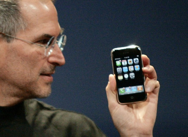 Former Apple Computer Inc. Chief Executive Officer Steve Jobs holds the new iPhone in San Francisco, California January 9, 2007.