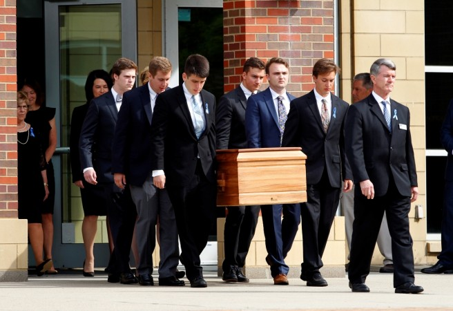 The casket of Otto Warmbier is carried to the hearse followed by his family and friends after a funeral service