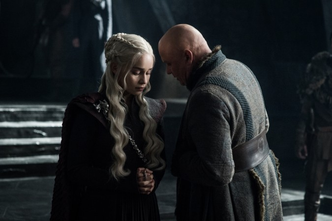 Emilia Clarke as Daenerys Targaryen with Conleth Hill as Lord Varys