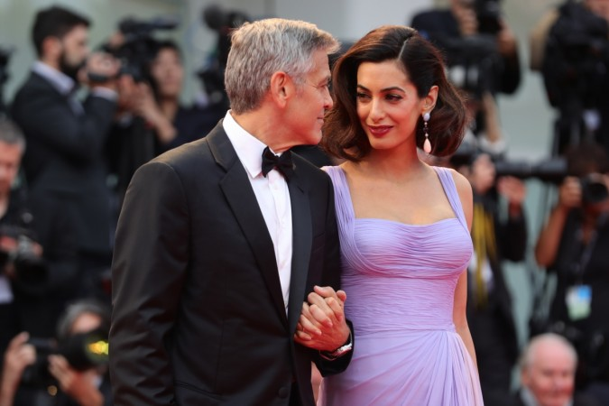 Amal Clooney channels Audrey Hepburn in a plunging Versace