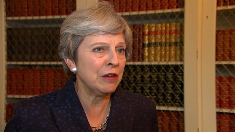 UK PM Theresa May defends response to Hurricane Irma