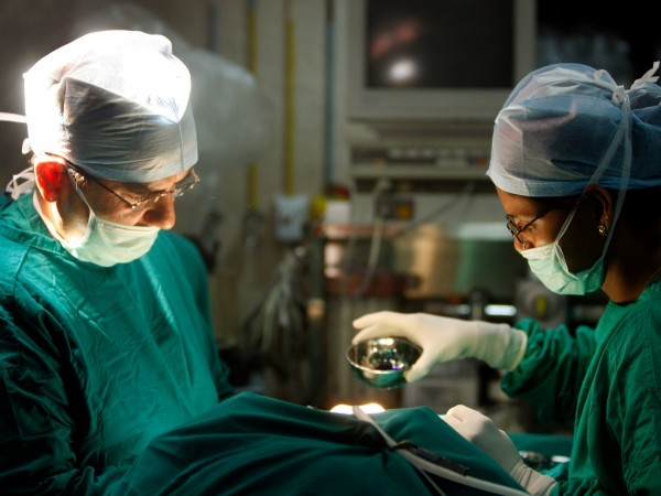 A surgeon and his assistant perform cosmetic surgery inside a hospital operation theater in Mumbai May 9, 2008. [Representational Image]