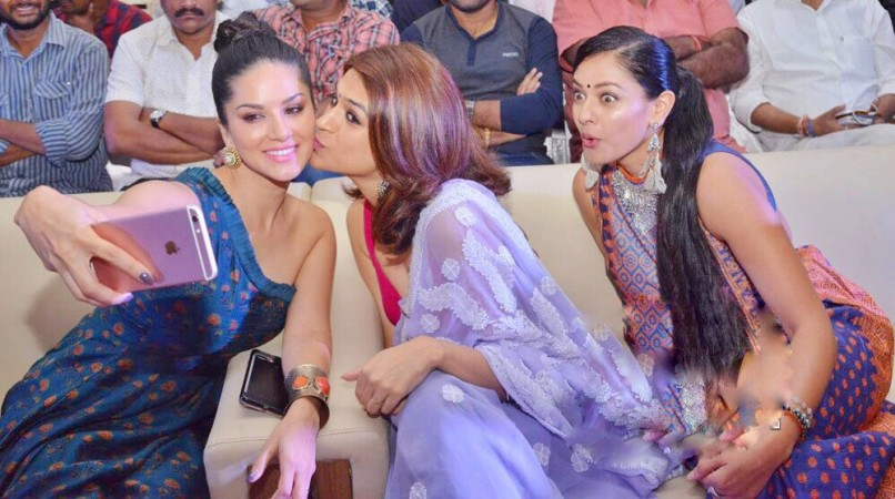 Shraddha Das kissing Sunny Leone at PSV Garuda Vega event