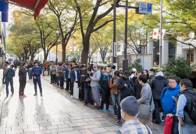 Customers queuing outside a store in Tokyo, Japan for iPhone X