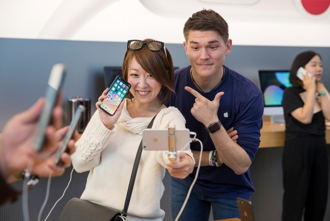 Customers in Tokyo, Japan taking selfie with iPhone X