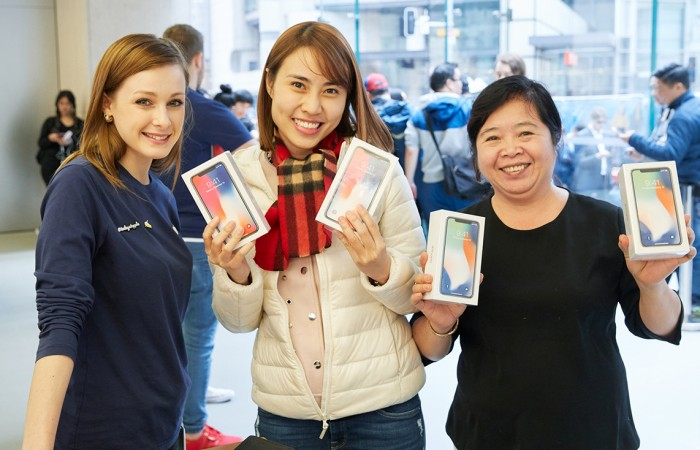 Customers with the new iPhone X in Sydney