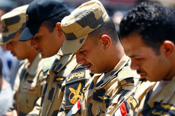Egyptian army officers react during the funeral of officer Khaled al-Maghrabi, who was killed during a suicide bomb attack