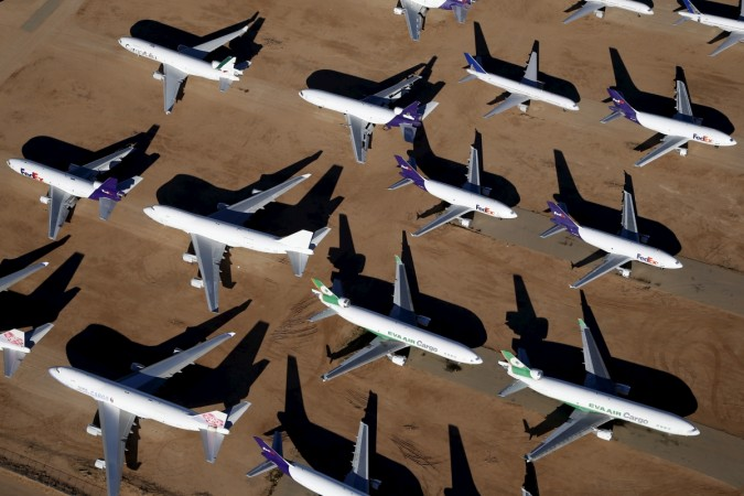 Old airplanes, including Boeing 747-400s, are stored in the desert in Victorville, California March 13, 2015.