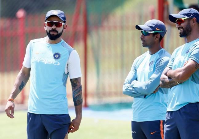 Virat Kohli, Wriddhiman Saha and Shikhar Dhawan