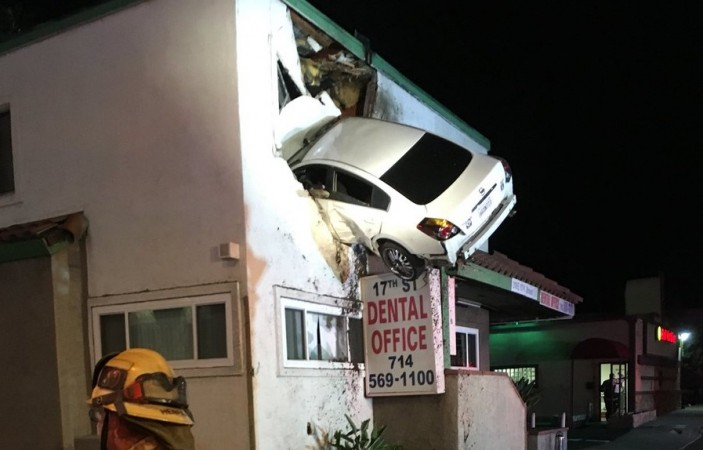 A car flew through the air and landed in a two-storey building in Santa Ana, California