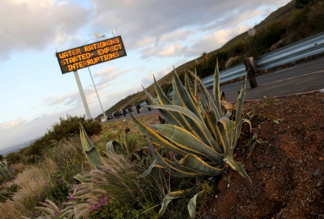 Sign warning residents of water restrictions is seen in Cape Town, South Africa