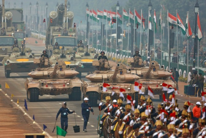 Indian soldiers in tanks take part in a full dress rehearsal for the Republic Day parade