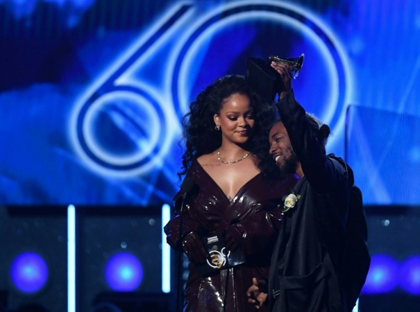 Recording artists Kendrick Lamar (R) and Rihanna (L) accept Best Rap/Sung Performance for 'Loyalty' during the 60th Annual Grammy Awards show on January 28, 2018, in New York
