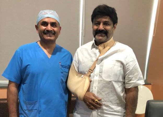 Nandamuri Balakrishna poses with a doctor at Continental Hospitals