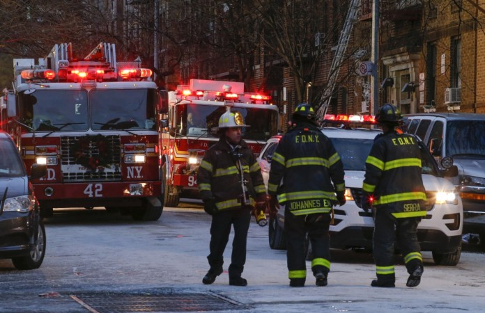 Fire Department of New York personnel work on the scene of an apartment fire on December 29, 2017 in the Bronx borough of New York City. Officials said Friday that the death toll from the fire has reached 12, including four children.