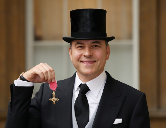 David Walliams poses for pictures after he was awarded an OBE for services to charity and the arts
