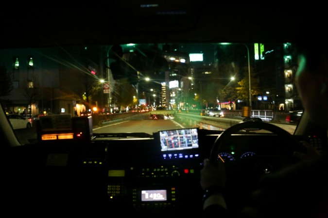 In this picture taken on December 12, 2017, a taxi driver uses a navigator while driving in Tokyo. Uber may be shredding business models for taxi firms the world over but it is struggling to make inroads in Japan, where risk-averse passengers prefer to st