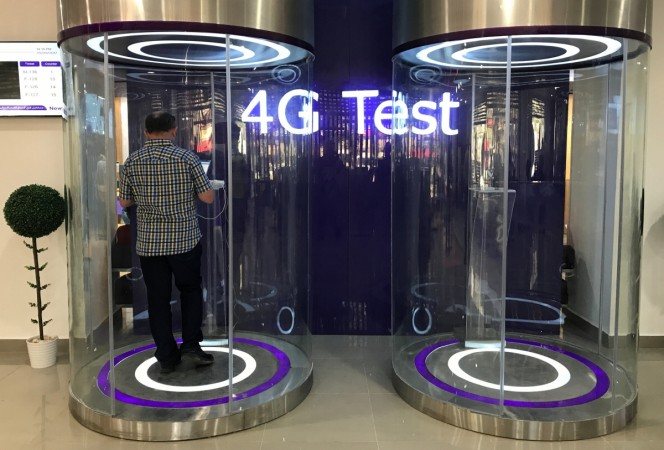 A customer tests his 4G services at a booth at Telecom Egypt's headquarters building in Cairo