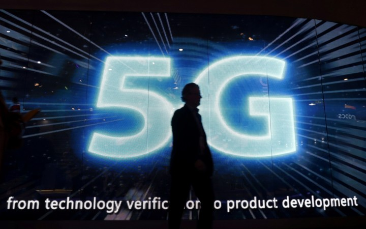 A visitors walks past a 5G sign during Mobile World Congress in Barcelona, Spain