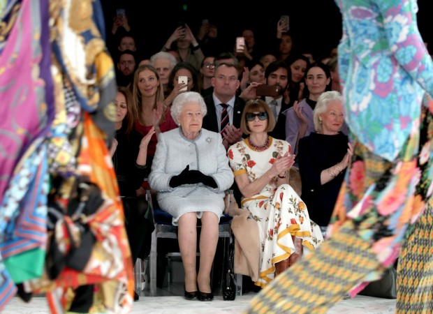 Britain's Queen Elizabeth II sits next to Vogue Editor-in-Chief Anna Wintour during the London Fashion Week.