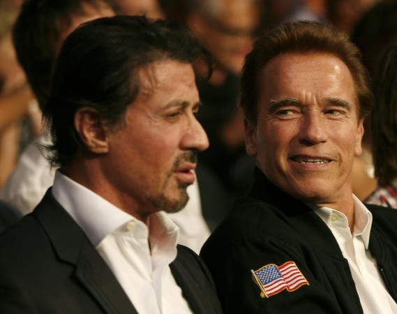 U.S. actor Sylvester Stallone (L) and California Governor Arnold Schwarzenegger wait for the start of the WBC Heavyweight Championship boxing bout between Vitali Klitschko of Ukraine and Cristobal Arreola of the U.S