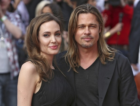 Angelina Jolie poses with her fiance Brad Pitt as they arrive for the world premiere of his film World War Z