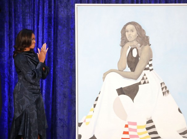 Former U.S. first lady Michelle Obama looks at her newly unveiled portrait during a ceremony at the Smithsonian's National Portrait Gallery