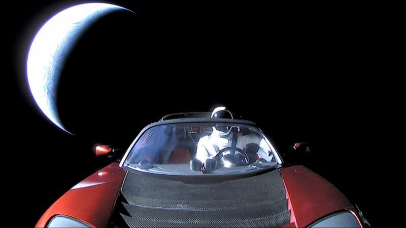 A cherry red Tesla Roadster automobile floats through space after it was carried there by SpaceX's Falcon Heavy in this image obtained by Reuters on February 9, 2018.