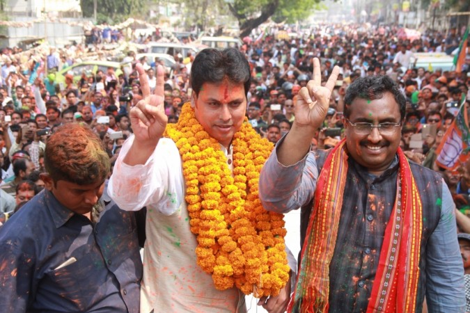 ripura BJP president Biplab Kumar Deb along with the party's National General Secretary Ram Madhav celebrate the party's performance in the recently concluded Tripura assembly elections, in Agartala on March 3, 2018.