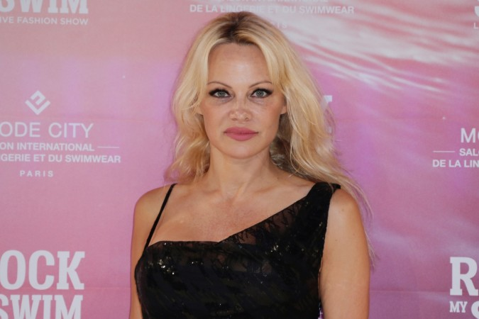 Pamela Anderson poses before attending the Rock My Swim by Mode City Paris fashion show in Paris on July 8, 2017.