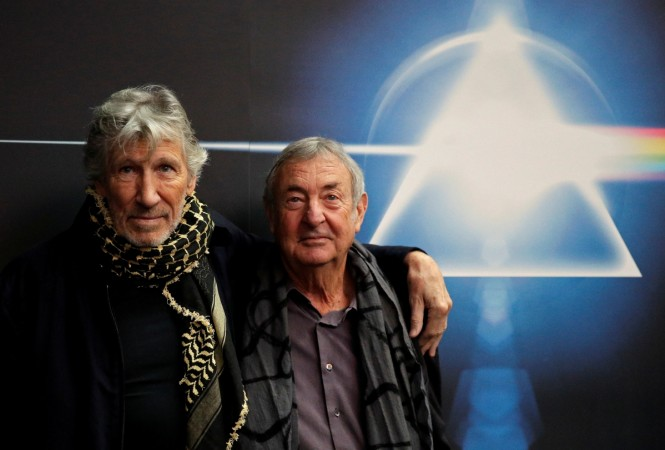 Band members Roger Waters (L) and Nick Mason pose before the unveiling of