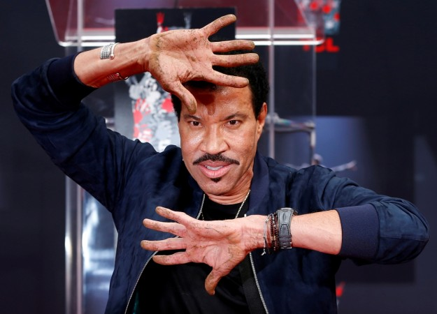 Recording artist Lionel Richie shows his hands after placing them in cement during a ceremony in the forecourt of the TCL Chinese theatre in Los Angeles, California, U.S., March 7, 2018.