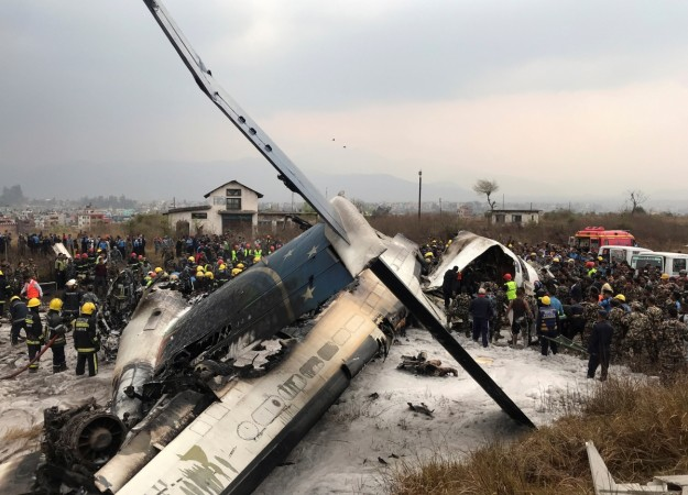 Wreckage of an airplane is pictured as rescue workers operate at Kathmandu airport, Nepal March 12, 2018.