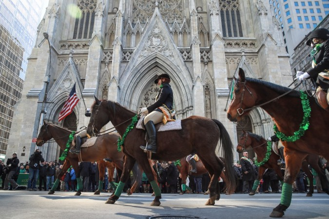 Members of the County Carlow Association ride horses as they march past St. Patrick's Cathedral on 5th Avenue during the annual St. Patrick's Day parade, March 17, 2017 in New York City. The New York City St. Patrick's Day parade, dating back to 1762, is
