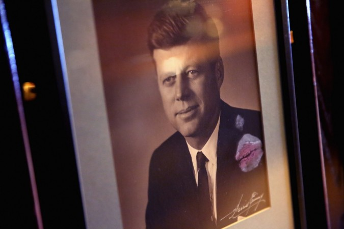 A lipstick print marks a framed photograph of former U.S. President John F. Kennedy at the National Press Club on the same day that former Texas Governor and Republican presidential candidate Rick Perry addresses the club luncheon July 2, 2015 in Washingt