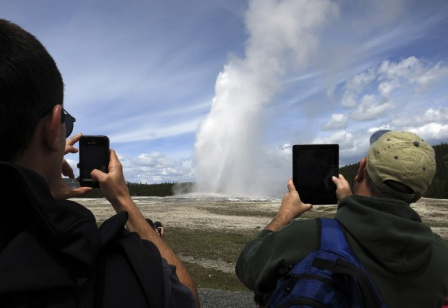 Old Faithful geyser erupting in Yellowstone National Park in Wyoming, May 16, 2014.