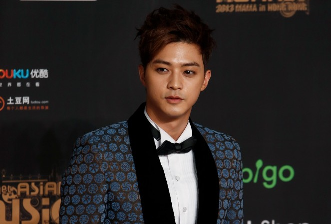 South Korean actor Kim Ji-hoon poses on the red carpet during the Mnet Asian Music Awards in Hong Kong November 22, 2013.