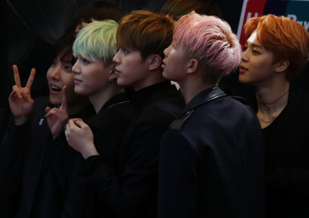 Members of South Korean K-Pop band BTS react on the red carpet during 2015 Mnet Asian Music Awards (MAMA) in Hong Kong, China, December 2, 2015.