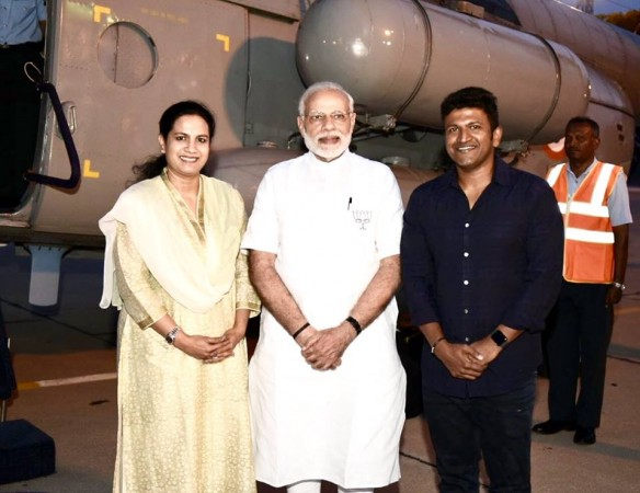Narendra Modi with Puneeth Rajkumar and his wife