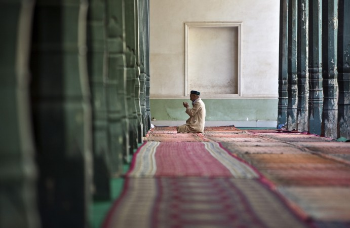 A Ugyhur Muslim worshiper prays inside the Kashgar Idgah mosque