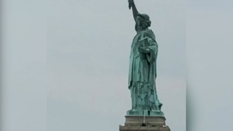 Woman Scales Statue Of Liberty On Fourth Of July
