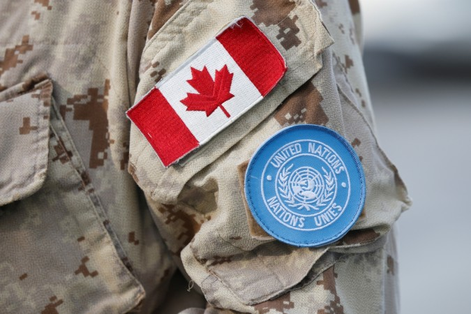 A Canada flag patch and U.N. patch