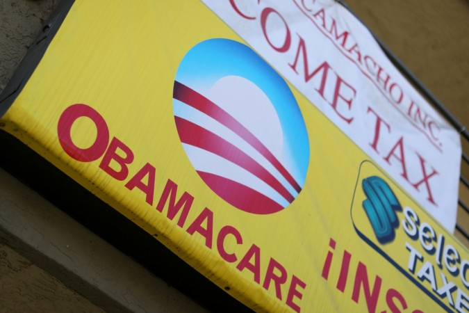 A sign on an insurance store advertises Obamacare in San Ysidro, San Diego, California,