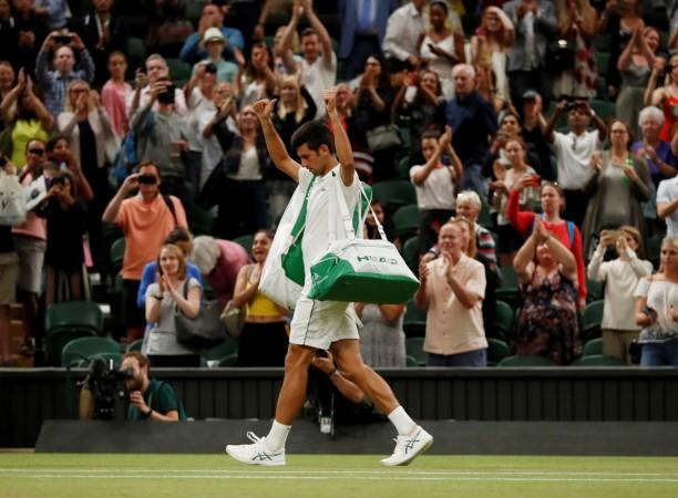 Novak Djokovic walks off the court