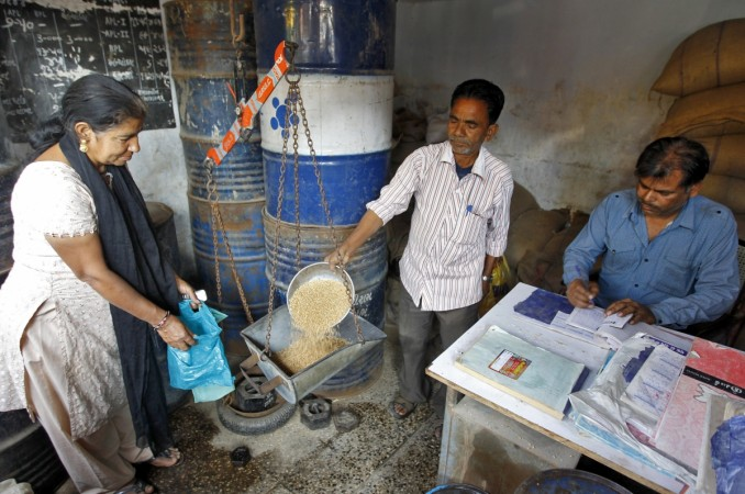 A woman buys wheat from a government-run ration shop