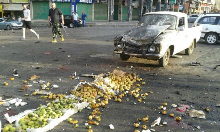 Damages after a suicide bomb attack are seen in Sweida, Syria