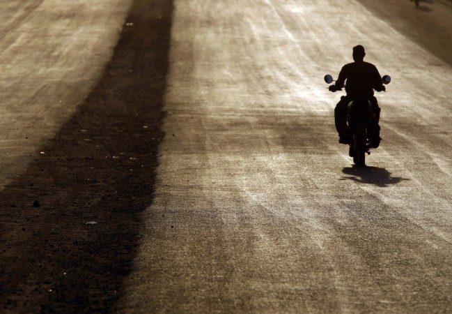 Africa road trip/ A southern Sudanese man rides a motorcycle during sunset in Juba, January 5, 2011. The referendum, guaranteed by a 2005 peace deal between north and south which ended Africa's longest civil war, is forecast to result in secession, but ex