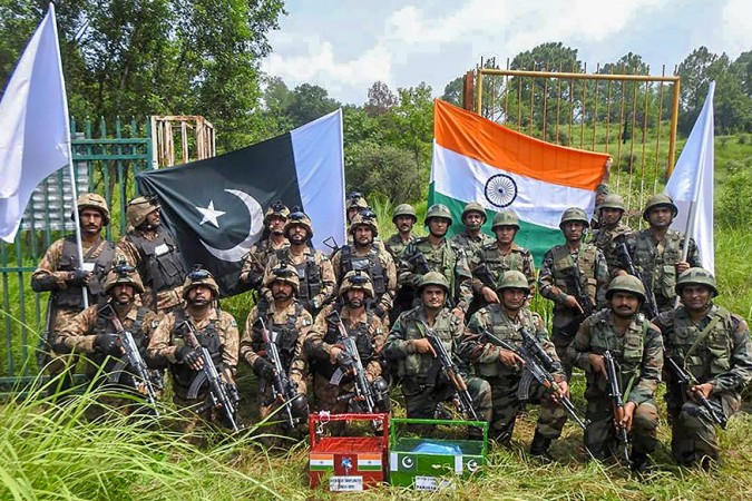 Indian and Pakistan Army celebrated Bakra Eid by exchanging sweets at Chakan Da Bagh Crossing point, near Poonch on August 22, 2018.