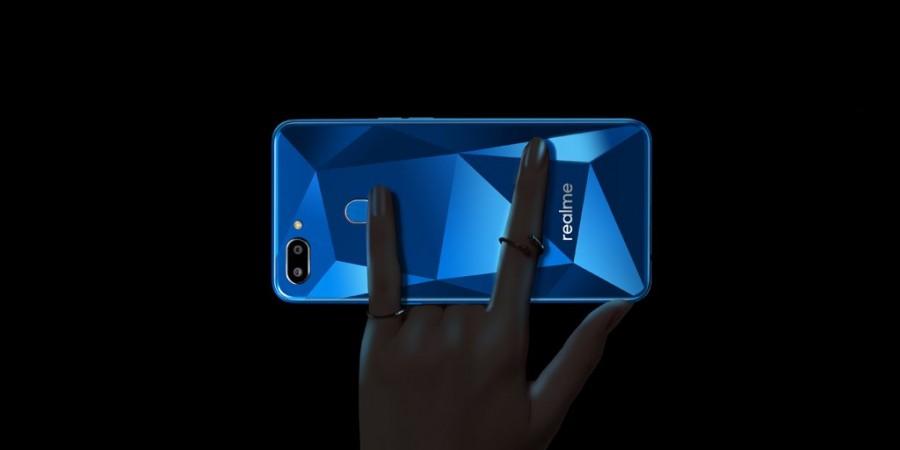 Realme 2 has a dual rear camera with fingerprint scanner on a diamond-cut back